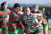 Sam Cole & Mathew Hamilton try to stop Matt Talaese's run. Counties Manukau Premier Club Rugby game between Wauku & Manurewa played at Waiuku on Saturday June 6th. Manurewa won 36 - 31 after leading 14 - 12 at halftime.
