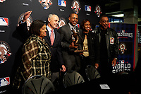 Curtis Granderson poses for photos with his family and commissioner Robert D. Manfred during the presentation of the Roberto Clemente Award before Game 3 of the Major League Baseball World Series between the Cleveland Indians and Chicago Cubs on October 28, 2016 at Wrigley Field in Chicago, Illinois.  (Mike Janes/Four Seam Images)