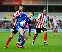 Lincoln City's Ollie Palmer vies for possession with Chesterfield's Jordan Flores<br /> <br /> Photographer Chris Vaughan/CameraSport<br /> <br /> The EFL Sky Bet League Two - Lincoln City v Chesterfield - Saturday 7th October 2017 - Sincil Bank - Lincoln<br /> <br /> World Copyright &copy; 2017 CameraSport. All rights reserved. 43 Linden Ave. Countesthorpe. Leicester. England. LE8 5PG - Tel: +44 (0) 116 277 4147 - admin@camerasport.com - www.camerasport.com