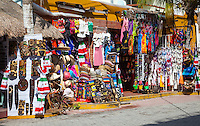 Souvenir Shops Selling Hats, Masks, Clothing, Paraphernalia.  Playa del Carmen, Riviera Maya, Yucatan, Mexico.