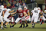 Wisconsin Badgers offensive lineman/center Travis Frederick (72) blocks as quarterback Russell Wilson (16) drops back to pass during an NCAA Big Ten Conference college football game against the Penn State Nittany Lions on November 26, 2011 in Madison, Wisconsin. The Badgers won 45-7. (Photo by David Stluka)