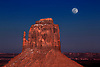 A full moon rises above Monument Valley, Arizona