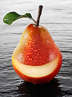Wole Red Williams pear with a smiley face