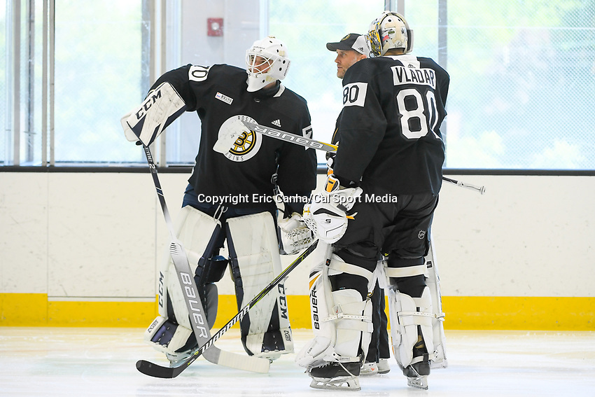 June 26, 2018: Boston Bruins goalie Jeremy Swayman (70) and goalie Dan Vladar (80) get coached during the Boston Bruins development camp held at Warrior Ice Arena in Brighton Mass. Eric Canha/CSM