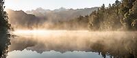 Reflections of Southern Alps in Lake Matheson at sunrise, Westland Tai Poutini National Park, West Coast, South Westland, UNESCO World Heritage Area, New Zealand, NZ