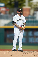 Charlotte Knights starting pitcher Hector Santiago (24) looks to his catcher for the sign against the Gwinnett Braves at BB&T BallPark on July 14, 2019 in Charlotte, North Carolina.  The Stripers defeated the Knights 5-4. (Brian Westerholt/Four Seam Images)