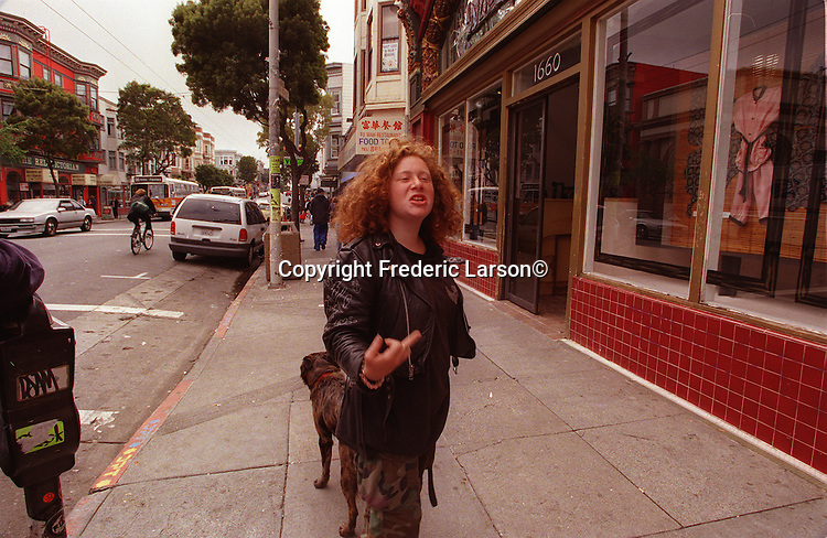Shera makes a crude gesture to aperson who disagrees with her street lifesytle on Haight Street in San Francisco, California.