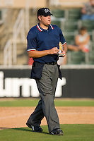 Home plate umpire Ryan Carle during a South Atlantic League game between the Rome Braves and the Kannapolis Intimidators at Fieldcrest Cannon Stadium July 26, 2009 in Kannapolis, North Carolina. (Photo by Brian Westerholt / Four Seam Images)