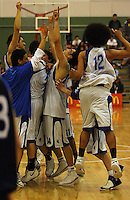 St Pats players celebrate victory during the NZ Secondary Schools Basketball Championships match between Fraser High School and St Patricks College at Arena Manawatu, Palmerston North, New Zealand on Saturday 4 October 2008. Photo: Dave Lintott / lintottphoto.co.nz