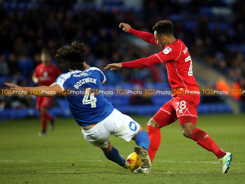 Nicky Maynard of MK Dons skips past a challenge from Peterborough's Michael Bostwick during Peterborough United vs MK Dons, Sky Bet EFL League 1 Football at London Road on 28th January 2017