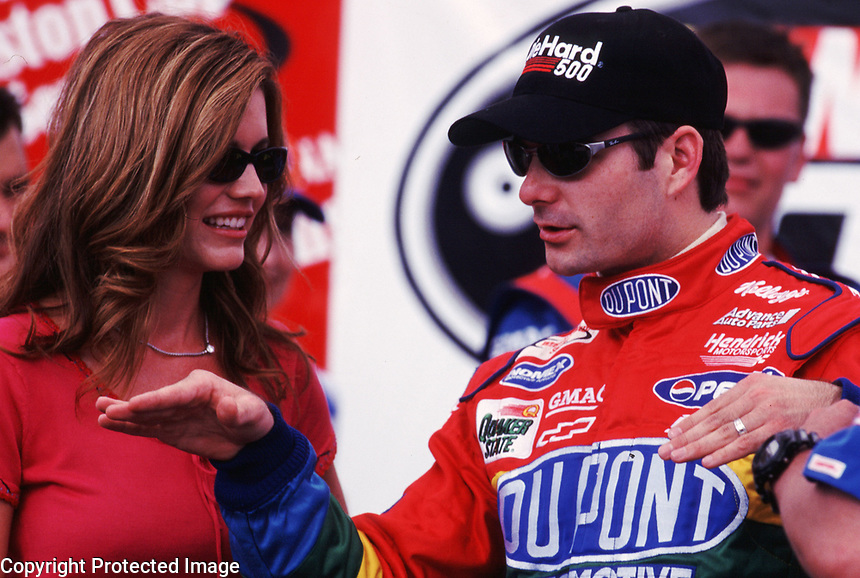 Jeff Gordon talks to his wife in victory lane at Talladega, AL after winning the Diehard 500 in April 2000. (Photo by Brian Cleary)