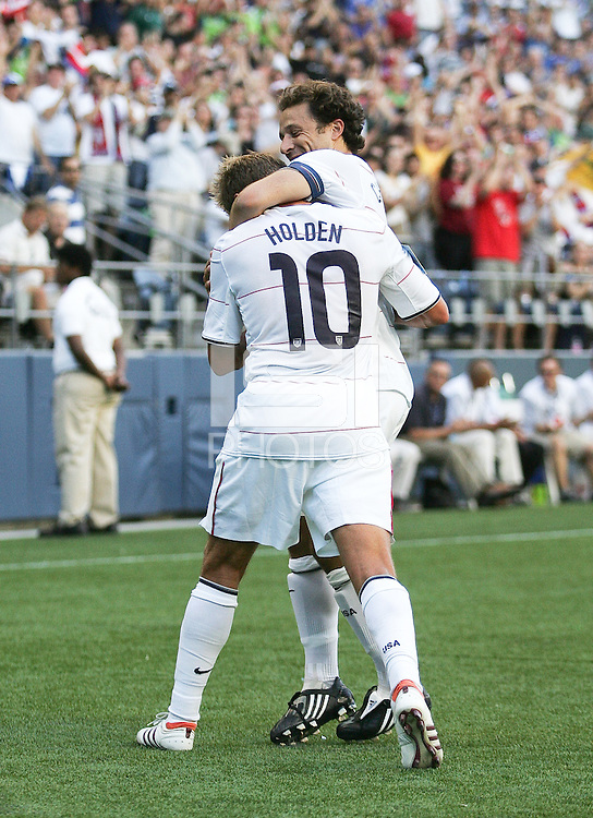 Stuart Holden (10) celebrates his goal with Steve Cherundolo (right). USA defeated Grenada 4-0 during the First Round of the 2009 CONCACAF Gold Cup at Qwest Field in Seattle, Washington on July 4, 2009.