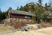 The Jim Liberty Cabin in the White Mountains of New Hampshire. This cabin is located along the Liberty Trail about a 1/2 mile from the summit of Mount Chocorua. It was built in 1934 and is secured down by two large chains. It is located at the site of the old Peak House. Built in 1891, the Peak House was blown off the mountain in 1915.