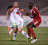 William Yomby (2) of the Richmond Kickers fights for the ball with Carlos Ruiz (20) of D.C. United during a third round match in the US Open Cup at City Stadium in Richmond, VA.  D.C. United advanced on penalty kicks after tying the Richmond Kickers, 0-0.