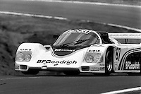 LAKEVILLE, CT - MAY 27: The BF Goodrich Porsche 962 106 driven by Jim Busby and Rick Knoop lifts a wheel en route to a sixth place finish during the Coca Cola 500 IMSA GTP/Lights race at Lime Rock Park near Lakeville, Connecticut, on May 27, 1985. (Photo by Bob Harmeyer)