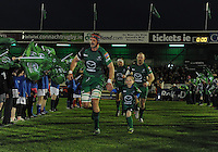 23rd November 2013; Connacht captain, Craig Clarke runs onto the pitch with match mascot, Jamie Connolly. Rabodirect Pro12, Connacht v Scarlets, Sportsground, Galway. Picture credit: Tommy Grealy/actionshots.ie.