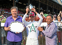Jose Ortiz receives the Angel Cordero award for leading jockey at Saratoga Race Course, Sep. 4.   (Bruce Dudek/Eclipse Sportswire)