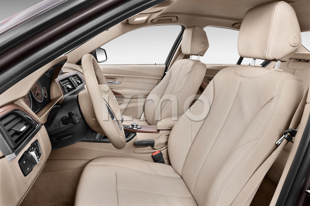 Front seat view of a 2012 - 2014 BMW 3-Series 320d Modern 4 Door Sedan.