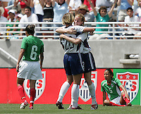 Abby Wambach, left, Cindy Parlow, right, USA v Mexico, 2004.