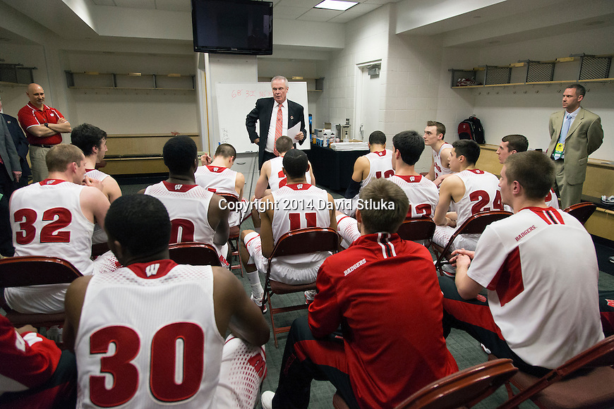 Wisconsin Badgers Head Coach Bo Ryan addresses his team in the locker room after  a regional semifinal NCAA college basketball tournament game against the Baylor Bears Thursday, March 27, 2014 in Anaheim, California. The Badgers won 69-52. (Photo by David Stluka)