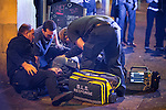"""© Joel Goodman - 07973 332324 . 19/12/2015 . Manchester , UK . Paramedics attend to a man lying on the pavement in the city's Northern Quarter . Revellers in Manchester enjoy """" Mad Friday """" - also known as """" Black Eye Friday """" - the day on which emergency services in Britain are typically at their busiest , as people head out for parties and drinks to celebrate Christmas . Photo credit : Joel Goodman"""