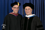 John Culbert, dean of The Theatre School, left, and commencement speaker and honorary degree recipient John Corigliano, a Grammy Award-winning American composer. DePaul University School of Music and The Theatre School held its commencement ceremony, Saturday, June 10, 2017, during the DePaul University School of Music and The Theatre School commencement ceremony at the Rosemont Theatre in Rosemont, IL. (DePaul University/Jeff Carrion)