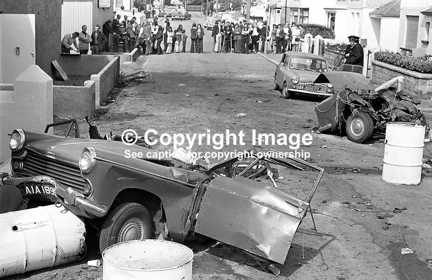 The scene of devastation in Causeway Road, Newcastle, Co Down, N Ireland, UK, after a Provisional IRA bomb exploded en route to a target. The bombers, an engaged couple, died instantaneously in the blast as their car was ripped apart. The incident happened just before midnight on 21st July 1973 in a quiet suburb of one of N Ireland's most popular seaside resorts. The couple, both 21 years, who died were Alphonsus Cunningham, from nearby Annalong, and Pauline Kane, from Castlewellan. 197307210513d<br /> <br /> Copyright Image from Victor Patterson, 54 Dorchester Park, Belfast, UK, BT9 6RJ<br /> <br /> t1: +44 28 9066 1296 (from Rep of Ireland 048 9066 1296)<br /> t2: +44 28 9002 2446 (from Rep of Ireland 048 9002 2446)<br /> m: +44 7802 353836<br /> <br /> e1: victorpatterson@me.com<br /> e2: victorpatterson@gmail.com<br /> <br /> The use of my copyright images is subject to my Terms &amp; Conditions.<br /> <br /> It is IMPORTANT that you familiarise yourself with them. They are available on my website at www.victorpatterson.com.<br /> <br /> None of my copyright images may be used on a website or on television unless they are visibly watermarked, i.e. &copy; Victor Patterson within the body of the visible image. The metadata of images used on the Internet must not be removed.<br /> <br /> Copyright acknowledgment of my images is a condition of use.<br /> <br /> Failure to observe the above conditions will incur a penalty of at least 100% of the agreed fee. <br /> <br /> Web use (maximum size - 400 kb) is extra at currently recommended NUJ rates.