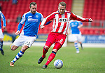 St Johnstone v Kilmarnock.....09.03.13      SPL.Sammy Clingan tracked by Rowan Vine.Picture by Graeme Hart..Copyright Perthshire Picture Agency.Tel: 01738 623350  Mobile: 07990 594431