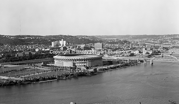 Pittsburgh PA:  View of Three Rivers Stadium on the North Side of Pittsburgh. Three Rivers Stadium was similar in design to other stadiums built in the 1960s and 1970s, such as Riverfront Stadium, the Houston Astrodome, and Busch Memorial Stadium, which were designed as multi-purpose facilities to maximize efficiency.