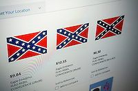 Confederate flag products for sale on the Sears website are seen on Tuesday, June 23, 2015. In lieu of the South Carolina controversy major retailers such as Amazon, Walmart and Sears and eBay will stop selling Confederate battle flag merchandise. (© Richard B. Levine)