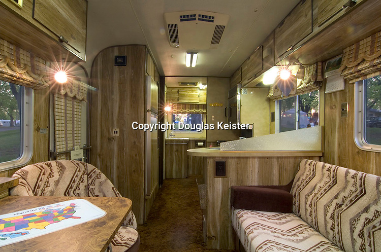 The interior of the Silver Streak is a perfect time capsule of 1978. Heavy dark brown, sculpted plush pile carpet covers the entire floor. The walls are sheathed in a faux-wood-grain plastic composite while other surfaces are covered in mottled yellow Formica. The generous 8-foot width allows for ample seating and includes a fully equipped kitchen and full bath. There is sleeping for four—the couch at the right converts into a bed and a queen-size bed (in back of the camera) is nestled into the space above the cab.