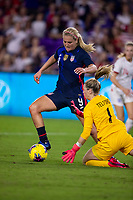 5th March 2020, Orlando, Florida, USA;  the United States midfielder Lindsey Horan (9) challenges England goalkeeper Carly Telford  during the SheBelieves Cup match between England and the USA on March 5, 2020, at Exploria Stadium in Orlando FL.