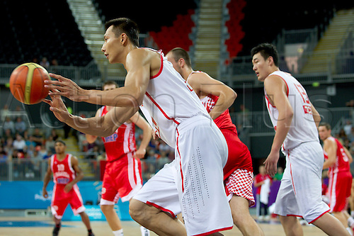 21.08.2011 LONDON, ENGLAND. Jianlian Yi of China passes as China play Croatia during the final day of the London 2012 Olympic Basketball Test Event, the London International Invitational from the Basketball Arena on the Olympic Site. Part of the London Prepares Series.