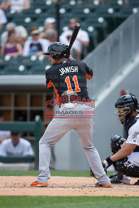 Paul Janish (11) of the Norfolk Tides at bat against the Charlotte Knights at BB&T BallPark on June 7, 2015 in Charlotte, North Carolina.  The Tides defeated the Knights 4-1.  (Brian Westerholt/Four Seam Images)
