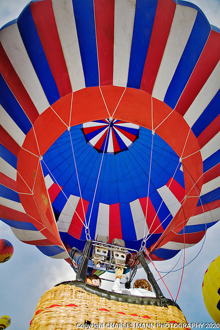 A hot air balloon rises at the mass assention at the 2009 Albuquerque Balloon Fiesta which is held in October of each  year.