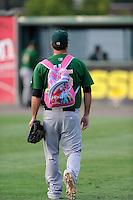 "Pitcher John Mincone (25) of the Savannah Sand Gnats carries snacks to the bullpen in a pink ""My Little Pony"" backpack before a game against the Greenville Drive on Friday, August 22, 2014, at Fluor Field at the West End in Greenville, South Carolina. Greenville won, 6-5. (Tom Priddy/Four Seam Images)"