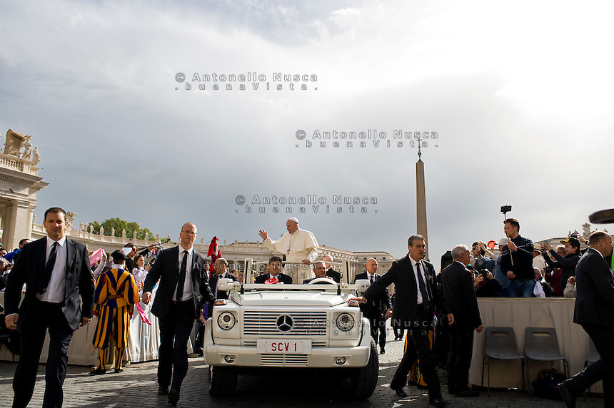 Vatican City, Vatican, April 13, 2016. Pope Francis waves to the faithful as he holds his weekly audience in St. Peter's Square in Vatican City, Vatican.