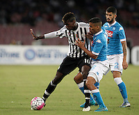 Calcio, Serie A: Napoli vs Juventus. Napoli, stadio San Paolo, 26 settembre 2015. <br /> Juventus&rsquo; Paul Pogba, left, is challenged by Napoli&rsquo;s Marques Allan, center, and Elseid Hysaj during the Italian Serie A football match between Napoli and Juventus at Naple's San Paolo stadium, 26 September 2015.<br /> UPDATE IMAGES PRESS/Isabella Bonotto