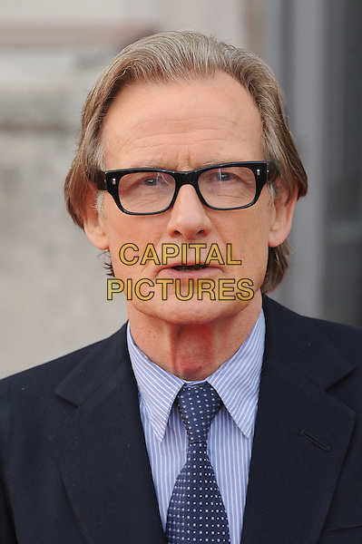 Bill Nighy <br /> attends the World Premiere of About Time, Somerset House, London, UK, 8th August 2013.<br /> portrait headshot navy blue suit tie glasses <br /> CAP/BEL<br /> &copy;Tom Belcher/Capital Pictures