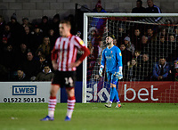 Lincoln City's Harry Toffolo, left, and Lincoln City's Grant Smith react after Port Vale's Emmanuel Oyeleke scored his sides equalising goal, to make the score 1-1<br /> <br /> Photographer Chris Vaughan/CameraSport<br /> <br /> The EFL Sky Bet League Two - Lincoln City v Port Vale - Tuesday 1st January 2019 - Sincil Bank - Lincoln<br /> <br /> World Copyright &copy; 2019 CameraSport. All rights reserved. 43 Linden Ave. Countesthorpe. Leicester. England. LE8 5PG - Tel: +44 (0) 116 277 4147 - admin@camerasport.com - www.camerasport.com