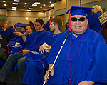 Charles David Silver waits with classmates before the TMCC Graduation held at Lawlor Events Center in Reno, Nevada on Friday, May 11, 2018.