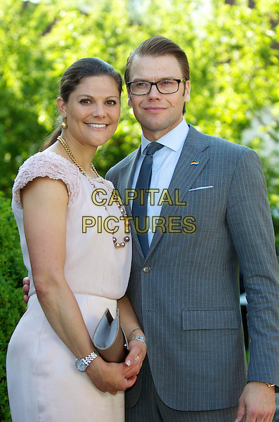 Crown Princess Victoria of Sweden, husband Prince Daniel, Duke of Västergötland, Westling attend the International Youth Library, Castle Blood Castle, Munich, 25 May 2011.royals royalty half length pink dress grey gray suit married wife.CAP/PPG/JH.©Jens Hartmann/People Picture/Capital Pictures