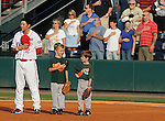 July 9, 2009: Young ballplayers share a laugh as they stand with Greenville Drive first baseman Jon Hee (2) during the National Anthem  before a game at Fluor Field at the West End in Greenville, S.C. Photo by: Tom Priddy/Four Seam Images
