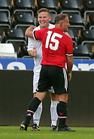Mark Gower of Swansea Legends (L) smiles to Clayton Blackmore of Manchester United Legends during the Alan Tate Testimonial Match, Swansea City Legends v Manchester United Legends at the Liberty Stadium, Swansea, Wales, UK