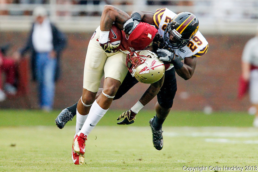 TALLAHASSEE, FLA 9/21/13-FSU-BCC092113CH-Florida State's Kelvin Benjamin is grabbed by Bethune-Cookman's Dion Hanks  during first half action Saturday at Doak Campbell Stadium in Tallahassee. <br /> COLIN HACKLEY PHOTO