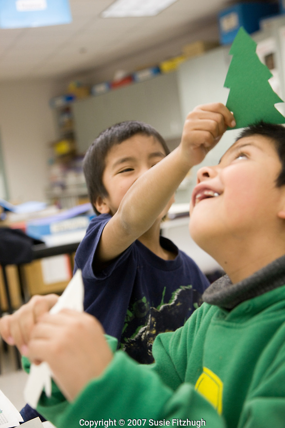 Arts Corps, Seattle: In Mark (Buphalo) Tomkiewicz's K-2 class at Cascade View Elementary, the children are learning about layers, perspective and other elements of artistic expression as they make images of forests and trees.
