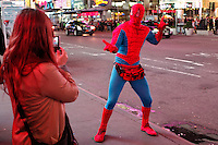 "NewYork, United States, October 07, 2011..A man dressed as ""spiderman"" poses for a picture in Times Square in central Manhattan New York October 7, 2011. VIEWpress / Kena Betancur. .On the 20th day of the ""Occupy Wall Street"" protest, Mayor Michael Bloomberg weighed in on the movement. He mostly criticized the group and said their actions are hurting the economy and tourism sector..Local Media Report."
