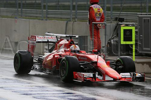 20.06.2015.  Red Bull Ring, Spielberg, Austria. F1 Grand Prix of Austria.   Scuderia Ferrari driver Sebastian Vettel comes down a wet pit lane