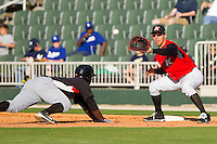 First baseman Rafael Vera #37 of the Kannapolis Intimidators waits for a pick-off throw as Odubel Herrera #2 of the Hickory Crawdads dives head first back to the base at Fieldcrest Cannon Stadium on April 17, 2011 in Kannapolis, North Carolina.   Photo by Brian Westerholt / Four Seam Images
