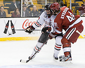 Mike McLaughlin (Northeastern - 18), Max Everson (Harvard - 44) - The Harvard University Crimson defeated the Northeastern University Huskies 3-2 in the 2012 Beanpot consolation game on Monday, February 13, 2012, at TD Garden in Boston, Massachusetts.